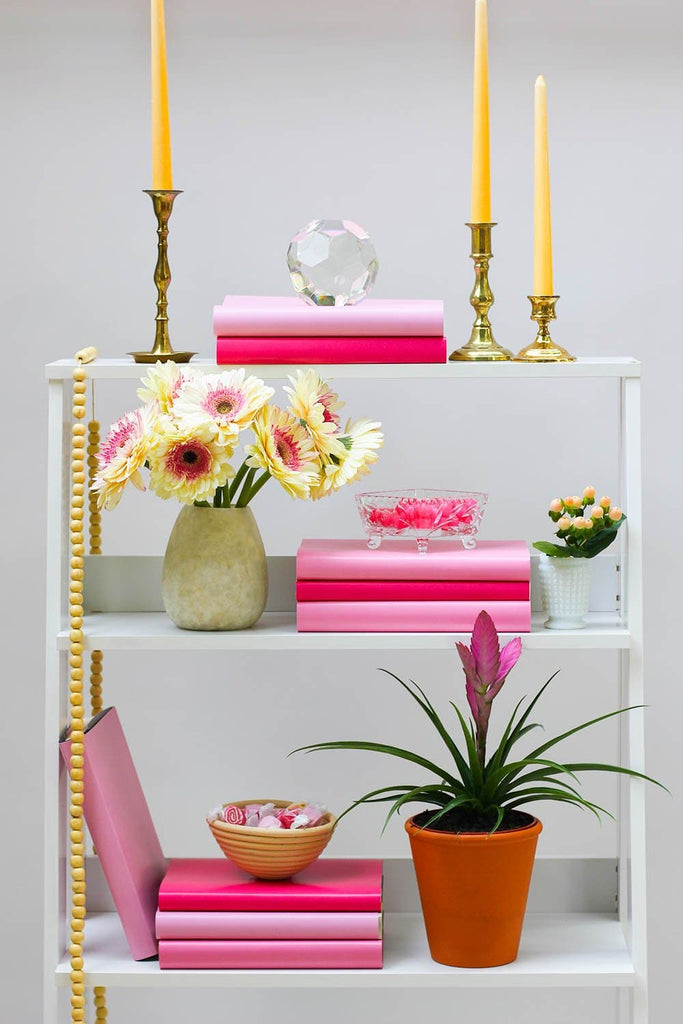 Styled pink book shelf with pink books from pink book covers