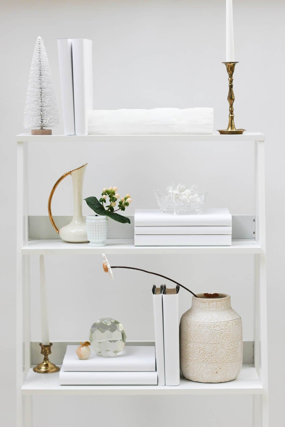 Styled white book shelf with white books from white book covers