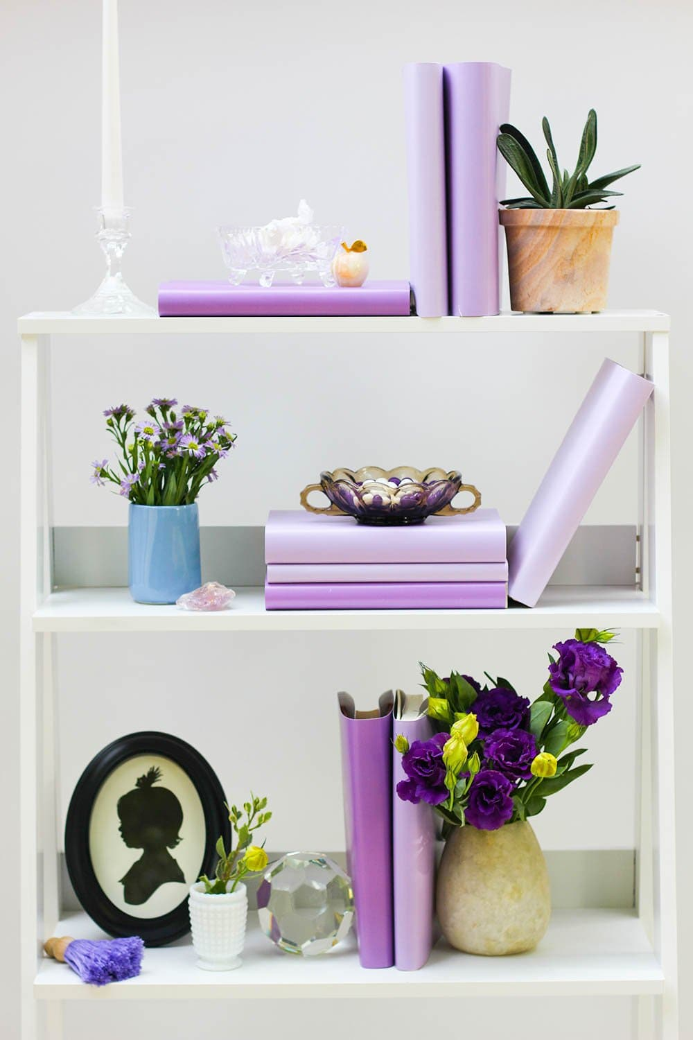 Styled purple book shelf with purple books from purple book covers