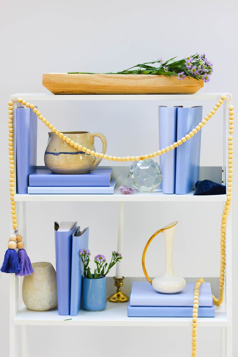 Styled periwinkle book shelf with periwinkle books from periwinkle book covers