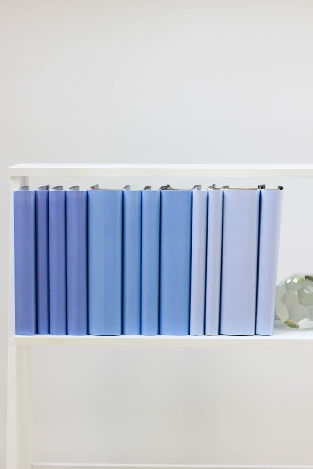 Set of styled periwinkle books made with periwinkle book covers