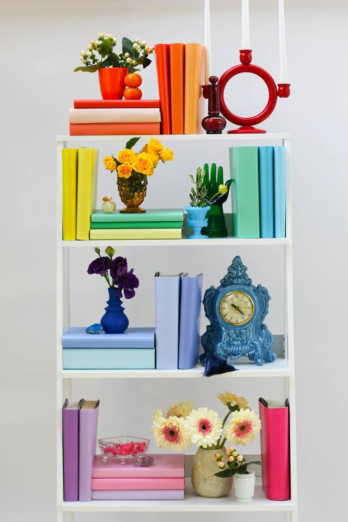 Styled rainbow book shelf with rainbow books from rainbow book covers