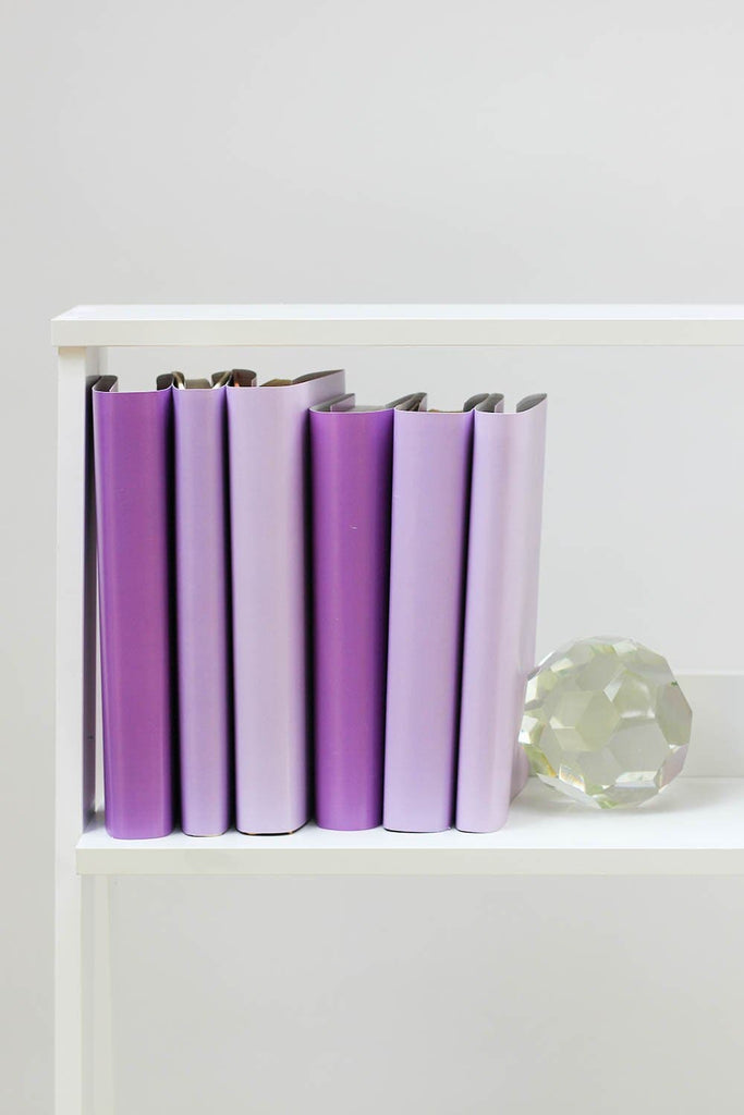Large and small purple books from purple book covers