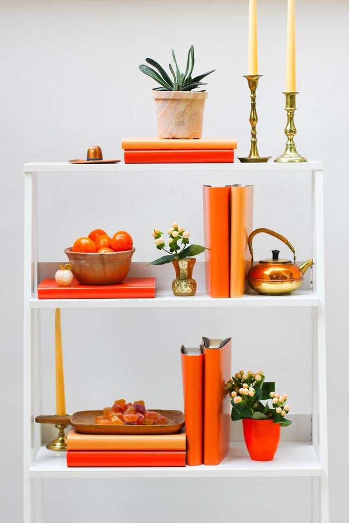 Styled orange book shelf with orange books from orange book covers