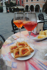 Pirlo-A wonderful drink of Aperol (the orange one) or Campari (the red one) with white wine. And of course a little snack!