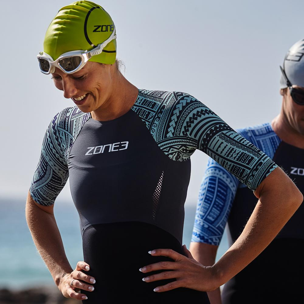 Women's Kona Target Short Sleeve Swimskin pose