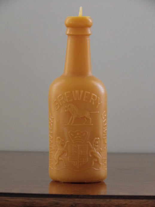 beeswax candle in the shape of an antique Alnwick brewery bottle