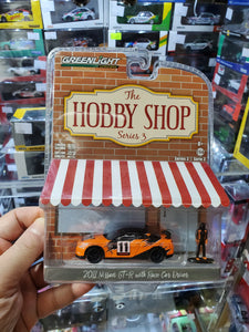 Greenlight 1/64 The Hobby Shop 2011 Nissan GTR with Race Car Driver