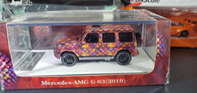 Load image into Gallery viewer, 1:64 MotorHelix Mercedes Benz G63 AMG Louis Vuitton LV 2019 Resin