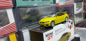 Mini GT MiniGT 1/64 BMW M4 (F82) Austin Yellow Metallic No.143
