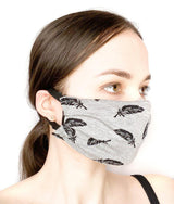 Side view of a girl wearing a custom size organic cotton face mask in feather print
