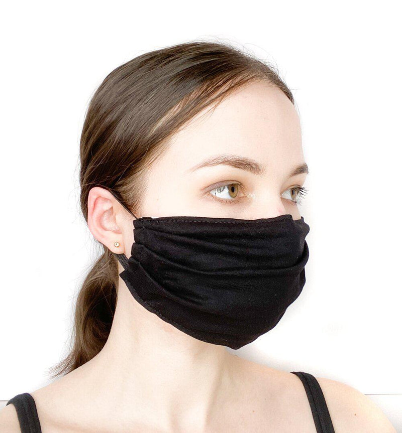 Side view of a girl wearing a custom size organic cotton face mask in black colour