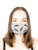 A girl wearing a custom size organic cotton face mask in feather colour