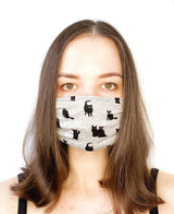 A girl wearing a custom size organic cotton face mask in cat print