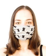 A girl wearing a custom size organic cotton face mask in dog print