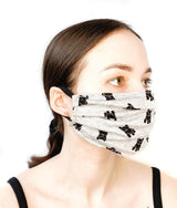 Side view of a girl wearing a custom size organic cotton face mask in dog print