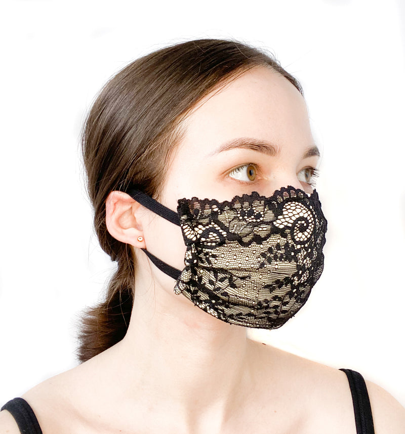 Side view of a girl wearing a custom size organic cotton face mask in premium black lace fabric