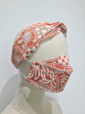 Mannequin with Orange Sekar Jagad matching headband and sampan mask