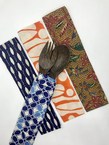 A fork and spoon cutlery set made from coconut timber in batik offcuts pouch