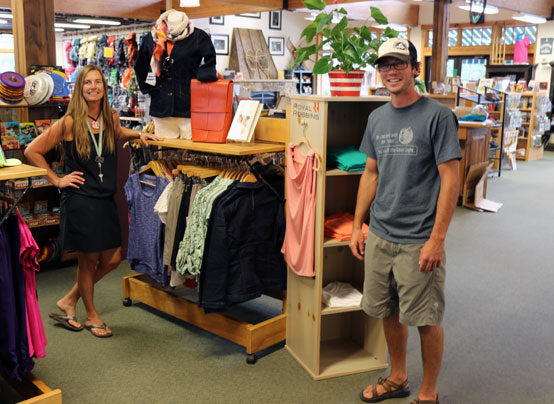Staff members Toni and Kyle in front of the Royal Robbins rack