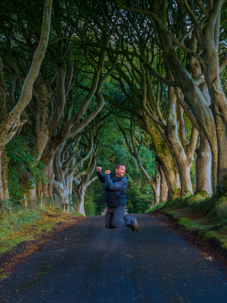 Dave jumps for joy at Dark Hedges.