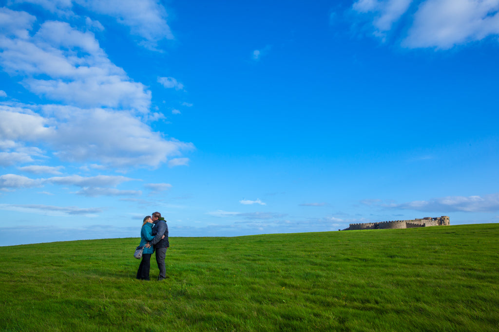 Stealing a kiss in front of Dunluce Castle.