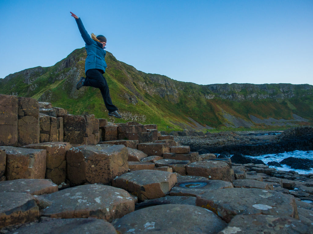 Deb takes a leap of faith on the Giant's Causeway.