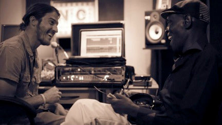 "Jacob Bain recording a song with the legendary Zimbabwean musician, Oliver ""Tuku"" Mtukudzi. Photo: Nasa Koski."