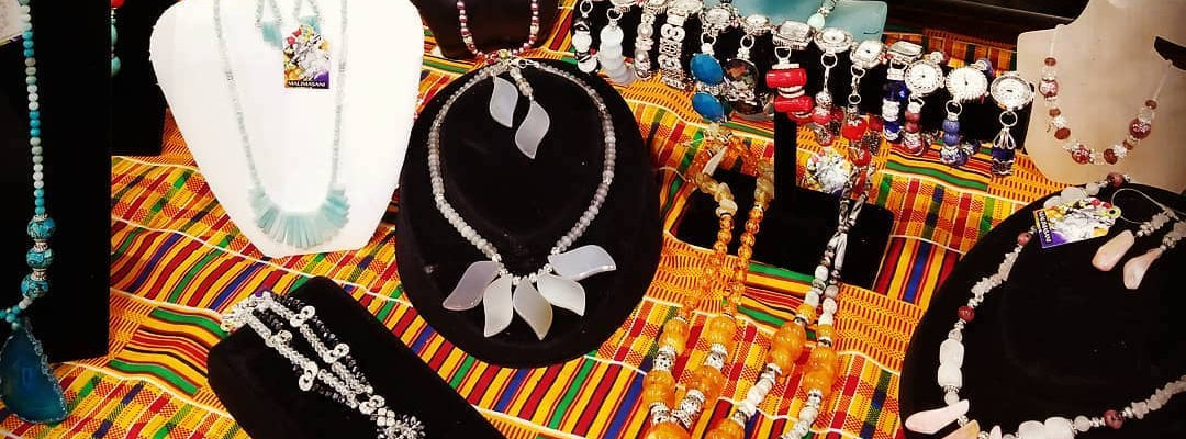 Handcrafted African jewelry displayed on a table
