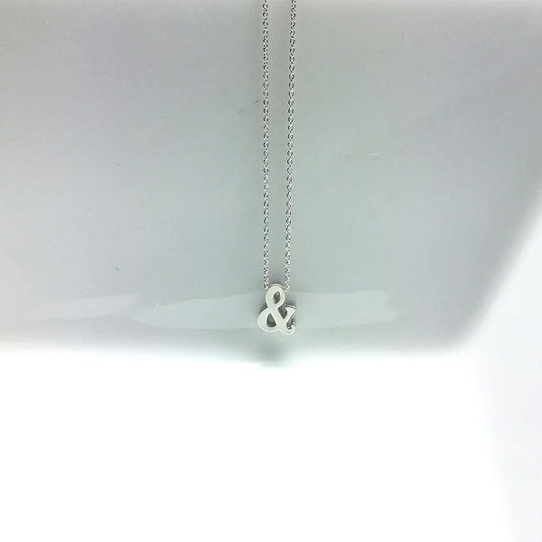 tiny silver matte and symbol charm necklace