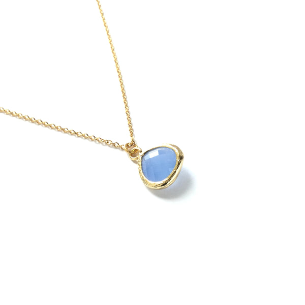Gold plated drop light blue blue faceted glass teardrop pendant on a gold plated chain necklace