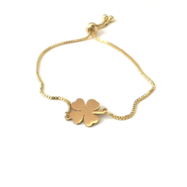 Gold stainless steel polished four leaf clover pendant on a gold stainless steel adjustable bracelet