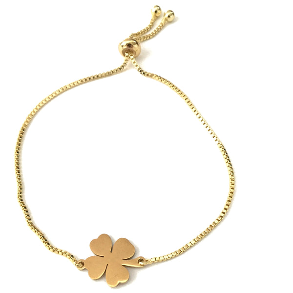 Gold stainless steel four leaf clover pendant on a gold stainless steel adjustable bracelet