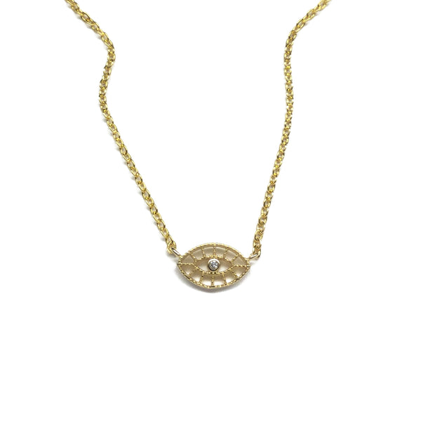 Gold evil eye shaped with a cubic zirconia stone in the centre and filigree design necklace