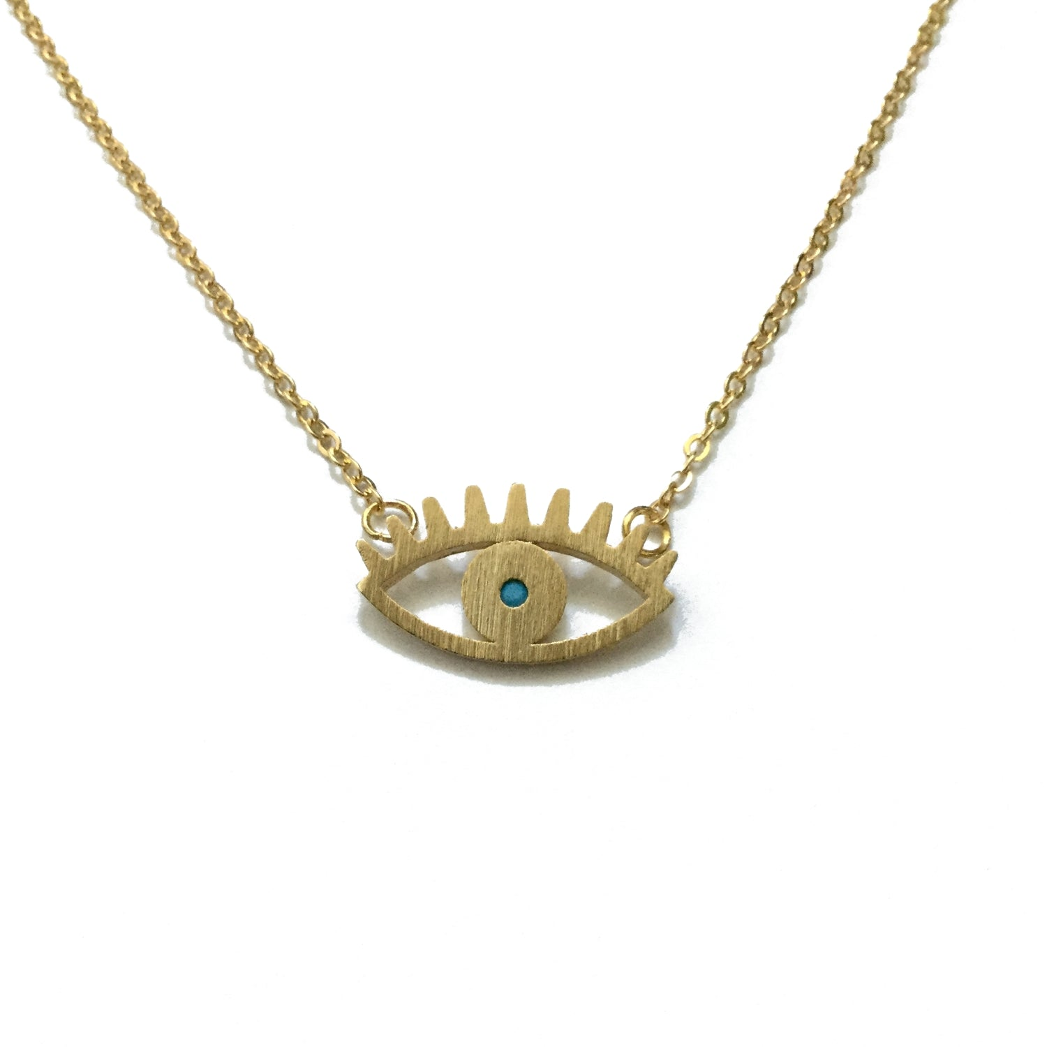 Gold plated matte evil eye with a tiny turquoise bead in the centre pendant necklace