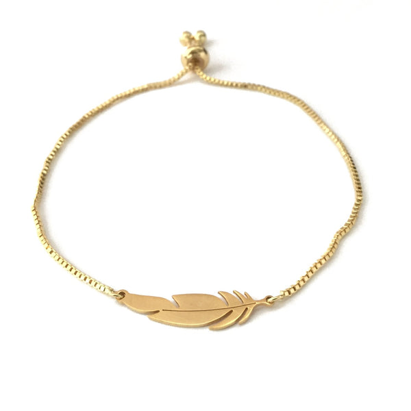 Gold stainless steel feather pendant on a gold stainless steel adjustable bracelet