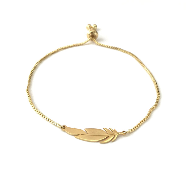 Gold stainless steel feather on an adjustable gold stainless steel bracelet
