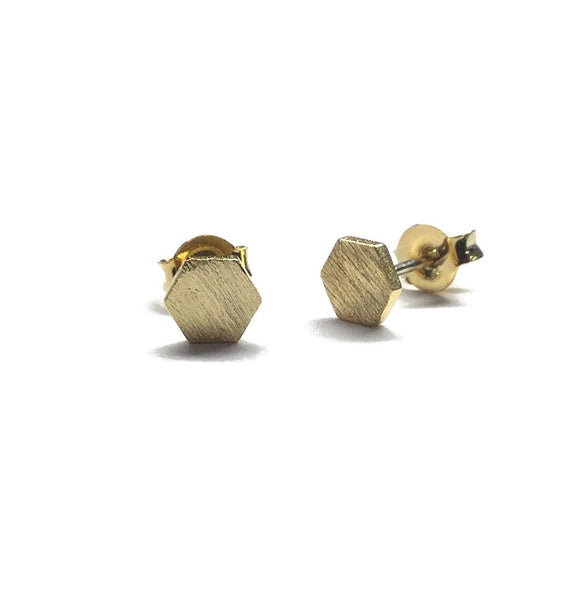 Tiny gold plated matte over brass hexagon stud earrings with sterling silver posts