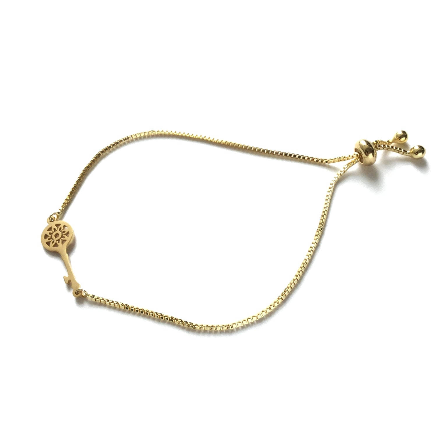 Gold stainless steel key on an adjustable gold stainless steel box chain bracelet