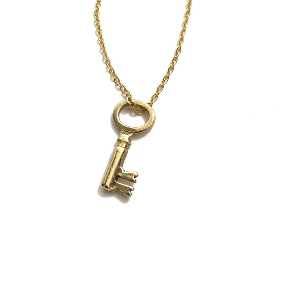small gold key pendant