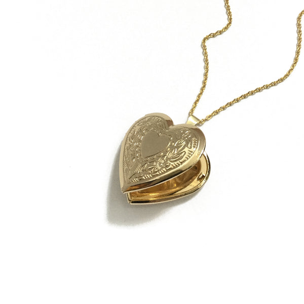 Gold plated heart locket with a floral heart design