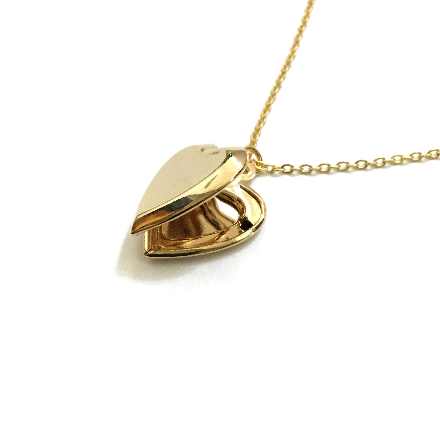 Gold plated heart shaped locket necklace