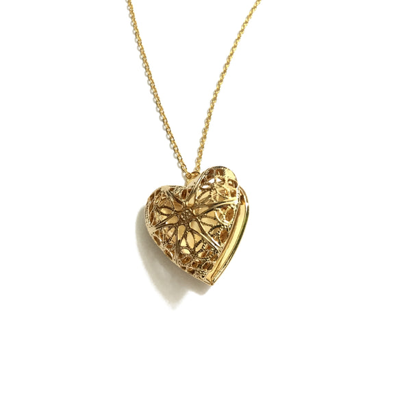 delicate gold plated heart shaped filigree locket