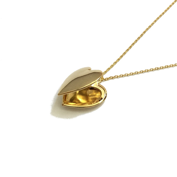 Plain and polished gold plated heart shaped locket