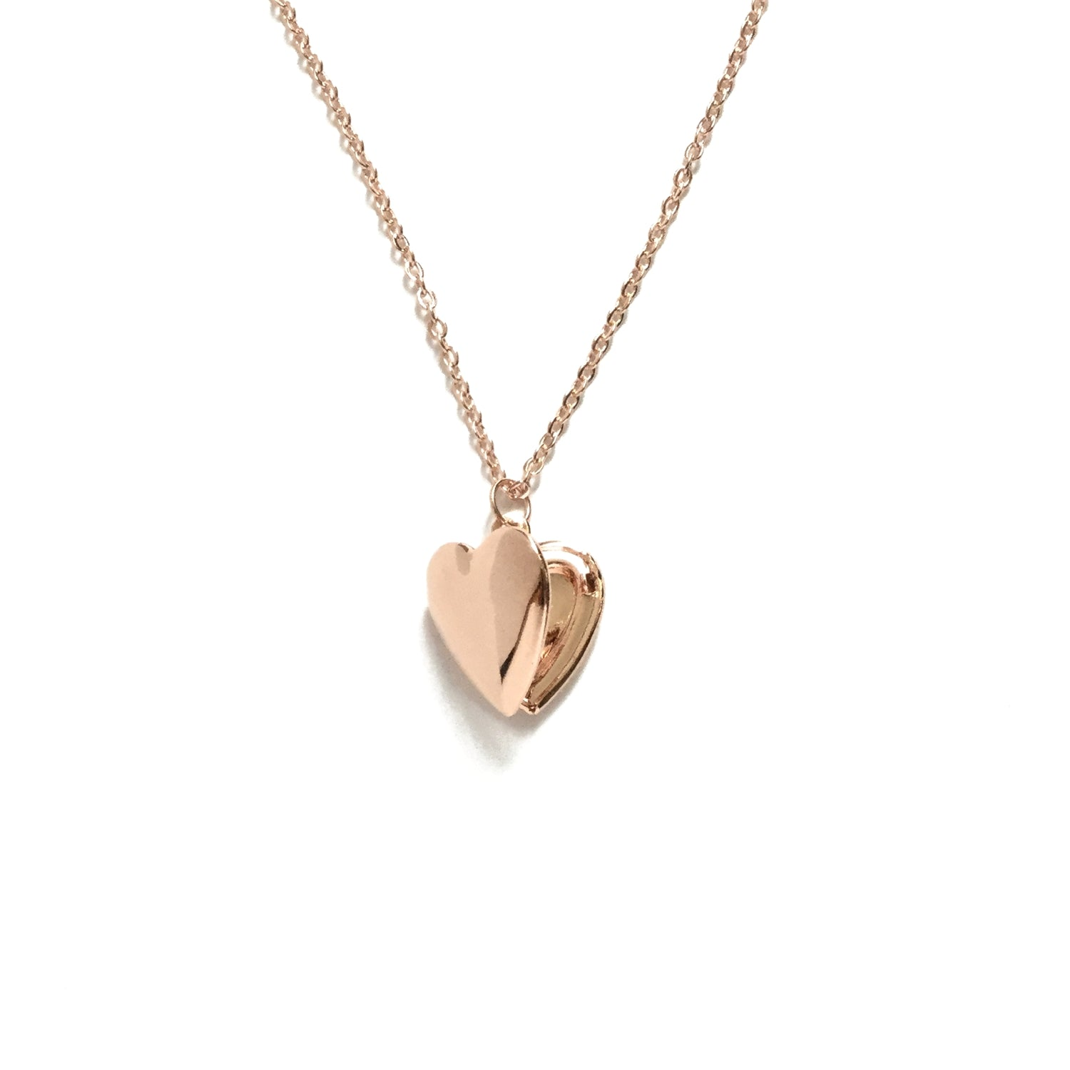 Tiny rose gold shiny heart shaped locket