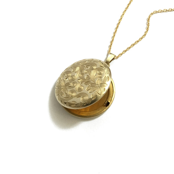 Gold plated shiny brass round floral locket
