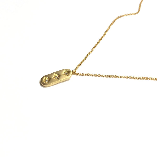 Gold plated oval north star pendant with three cubic zirconia in a vertical row pendant necklace
