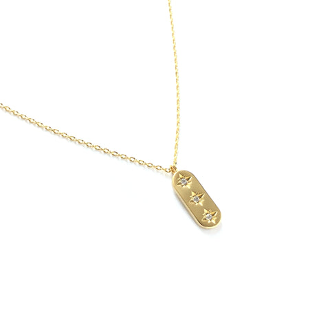 Gold plated oval pendant with three cubic zirconia in a vertical row pendant necklace