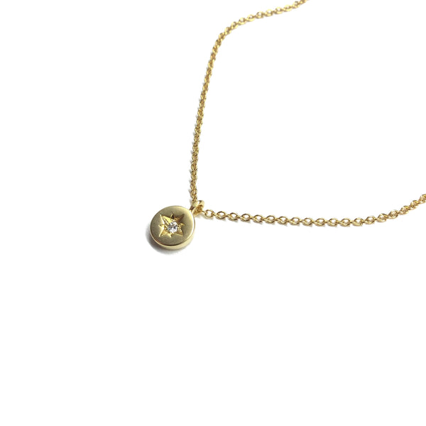 Tiny gold plated cubic zirconia star coin necklace