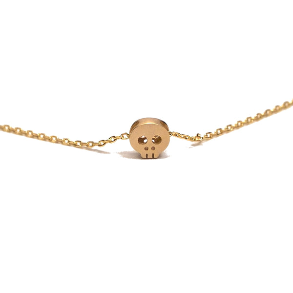 tiny gold skull necklace